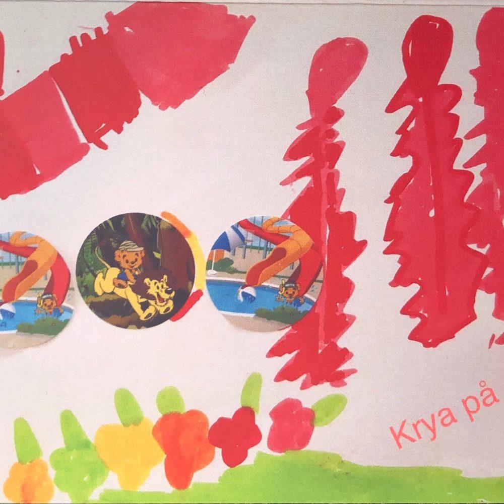 """Ett kort skapat av våra unga konstnärer, med texten """"Krya på dig"""". Röda, gröna, gula och orange färger med bamse."""